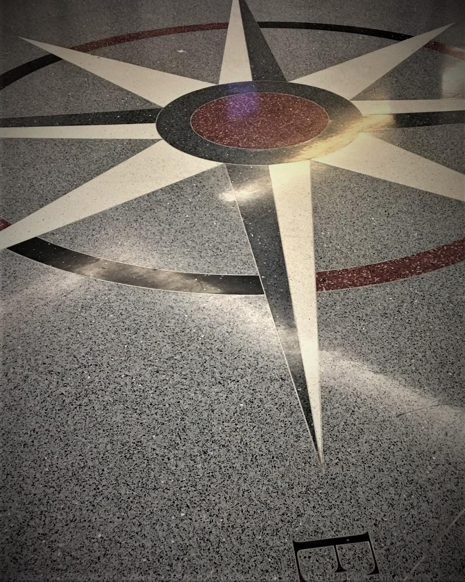 A compass star floor mosaic